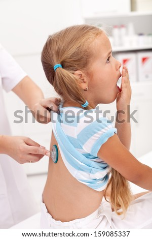 Coughing little girl at the doctor - respiratory system diseases in childhood