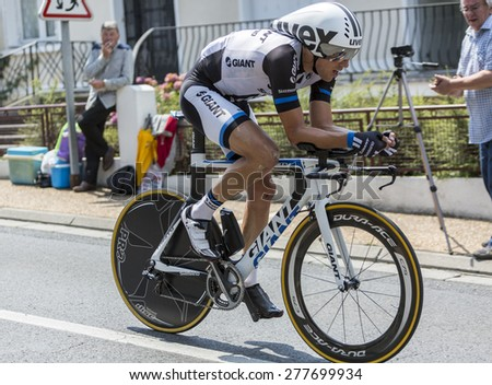 COULOUNIEIX-CHAMIERS,FRANCE-JUL26: The Dutch cyclist Koen de Kort (Giant-ShimanoTeam) pedaling during the stage 20 ( time trial Bergerac - Perigueux) of Le Tour de France 2014. - stock photo