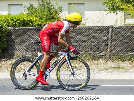 COULOUNIEIX-CHAMIERS,FRANCE-JUL26:The French cyclist Julien Simon (Cofidis Team) pedaling during the stage 20 ( time trial Bergerac - Perigueux) of Le Tour de France 2014.  - stock photo