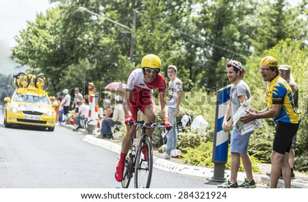 COULOUNIEIX-CHAMIERS,FRANCE-JUL26:The French cyclist Nicolas Edet (Cofidis Team) pedaling during the stage 20 ( time trial Bergerac - Perigueux) of Le Tour de France 2014. - stock photo
