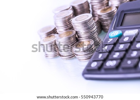 Couns and calculator on white background. Studio shot