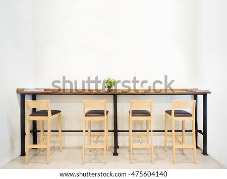 Counter In Cafe Bar With Empty Space White Wall .