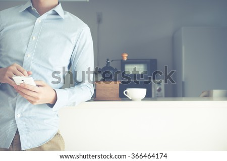 Counter kitchen, men and smart phone - stock photo
