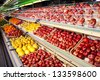 Counter with fruits in supermarket - stock photo