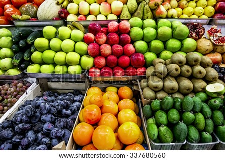Counter with ripe colorful fruit in market