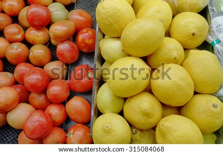 Counter with vegetable and fruit in supermarket - stock photo