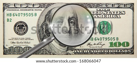 counterfeit coin magnifying glass isolated