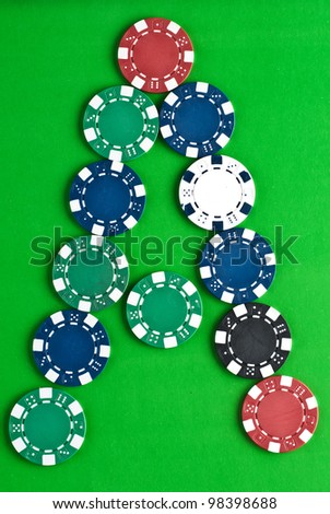 Counters for game in a casino on green a background