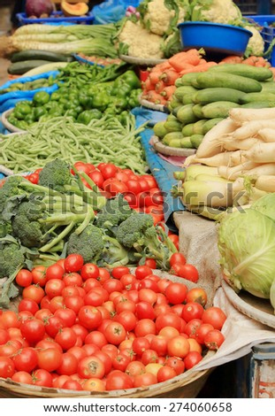 Countertop with vegetables at the market in Kathmandu, Nepal, background  - stock photo
