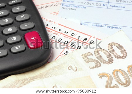 Counting and paying bills with Czech money. - stock photo