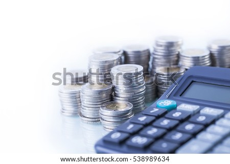 counting income, pile of money, calculator in white background
