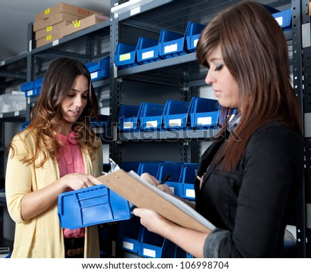 Counting Inventory in a Stockroom - stock photo