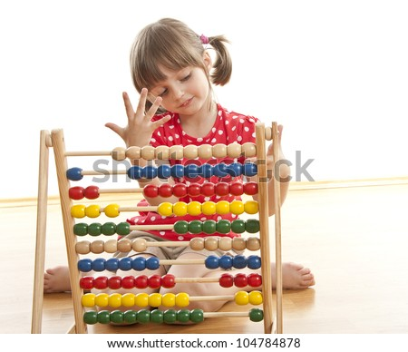 counting little girl with abacus - stock photo