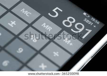 Counting on calculator display smartphone. - stock photo