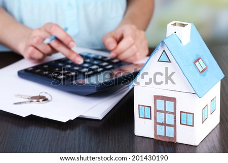 Counting property prices - stock photo