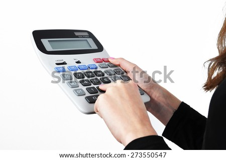 Counting with a big calculator isolated on a white background