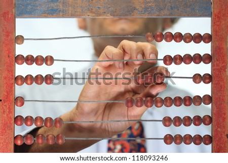 counting with an old wooden abacus