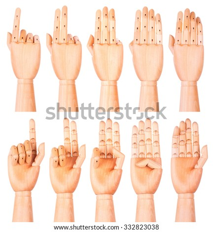 Counting wooden hands (1 to 5) isolated on white background - stock photo