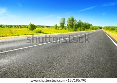 Country asphalt road on summer day. - stock photo