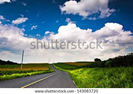 Country backroad through farms in Southern York County, Pennsylvania. - stock photo