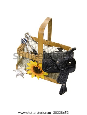 Country basket with a saddle made of heavy black leather, silver spurs, and a sheriff badge - path included - stock photo