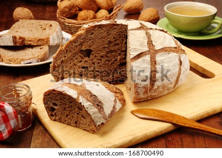 Country bread on the wooden cutting board
