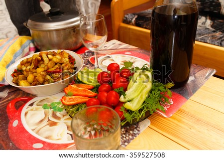 Country Buffet. Fried potatoes, tomatoes, peppers and wine