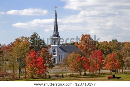 Country Church -- A small Catholic Church stands amid the changing colors of the trees -- Parnell, Michigan.