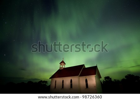 Country Church and Northern Lights in Saskatchewan Canada - stock photo