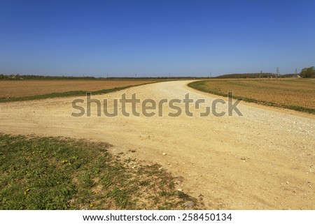 Country cross-way  in a sunny day. - stock photo