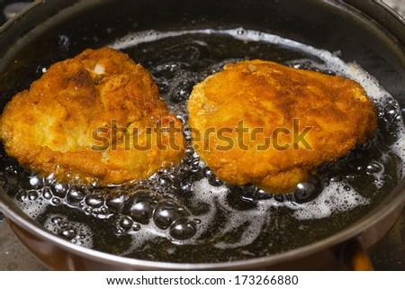 country fried chicken in hot oil