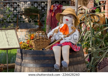 Country Girl Rag Doll Sitting over a Barrel