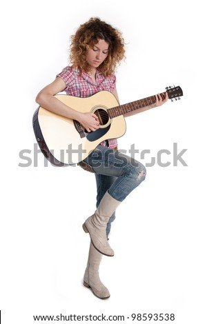 Country girl with a guitar against white background.