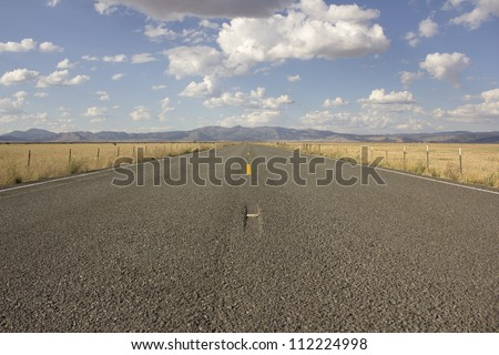 Country Highway - Highway and Sky with clouds - stock photo
