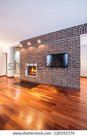 Country home - Brick wall in contemporary living room - stock photo