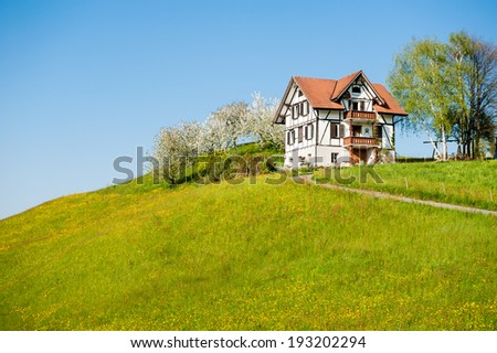 Country house in rural landscape