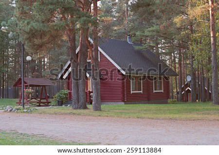 country house in the forest in summer - stock photo