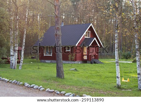 country house in the forest in summer