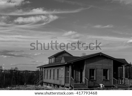 Country house in the village in the spring - stock photo