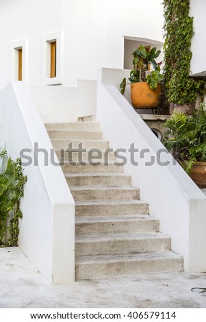 country house overlooking garden with Mexican decoration - stock photo