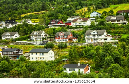 Country houses in small Norwegian town Olden. - stock photo