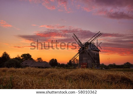 country landscape with the windmill at sunrise