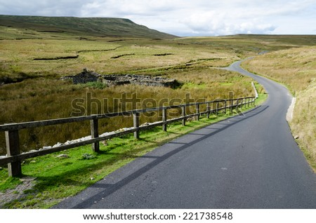 Country road across the moor from Swaledale - stock photo
