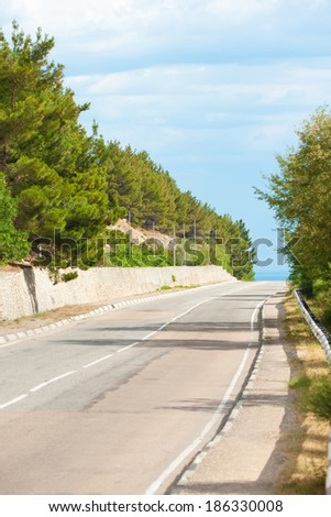 country road and blue sky - stock photo