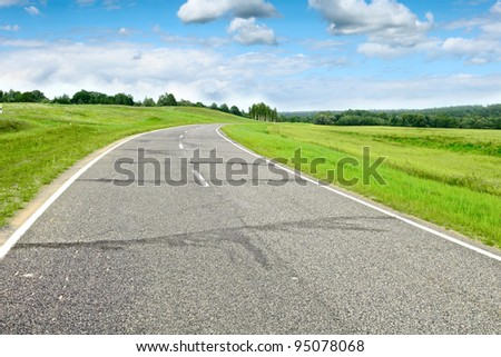 Country road at summer sunny beautiful day - stock photo