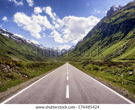 country road at the european alps - stock photo