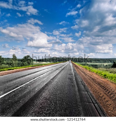 Country road disappearing into the distance. Panorama. Rural landscape. - stock photo