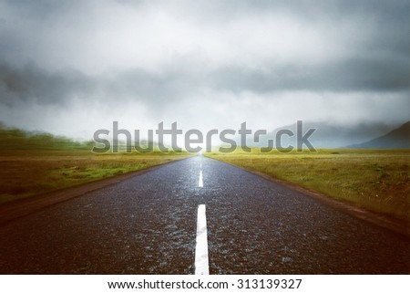 Country road goes into clouds