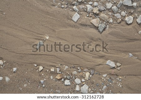 Country road. Gravel, pebbles and sand close up