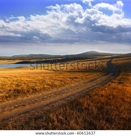 Country road in autumn day.